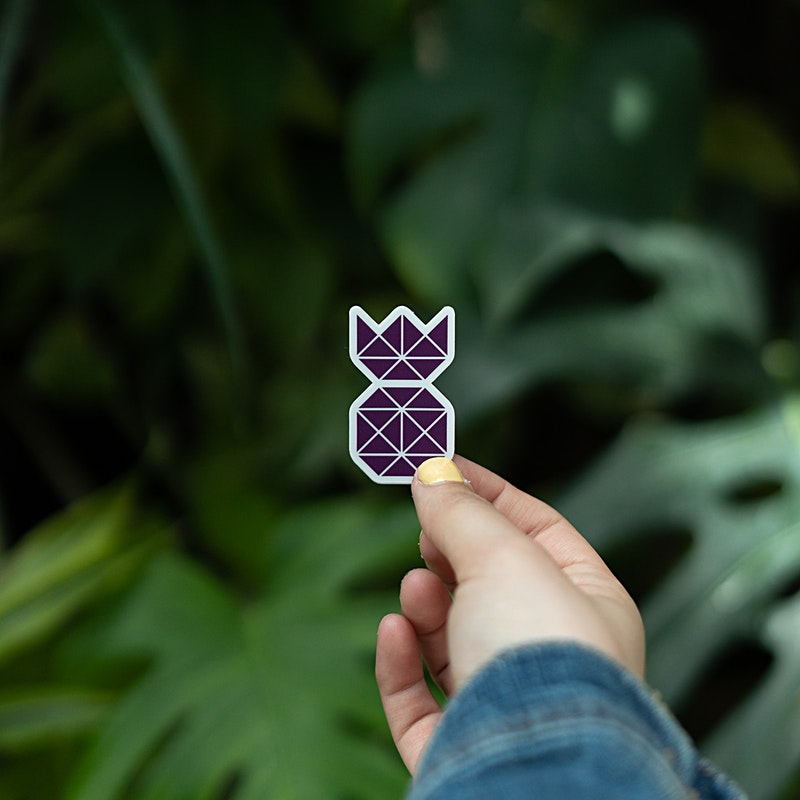 Purple pineapple Sticker with girl holding it out