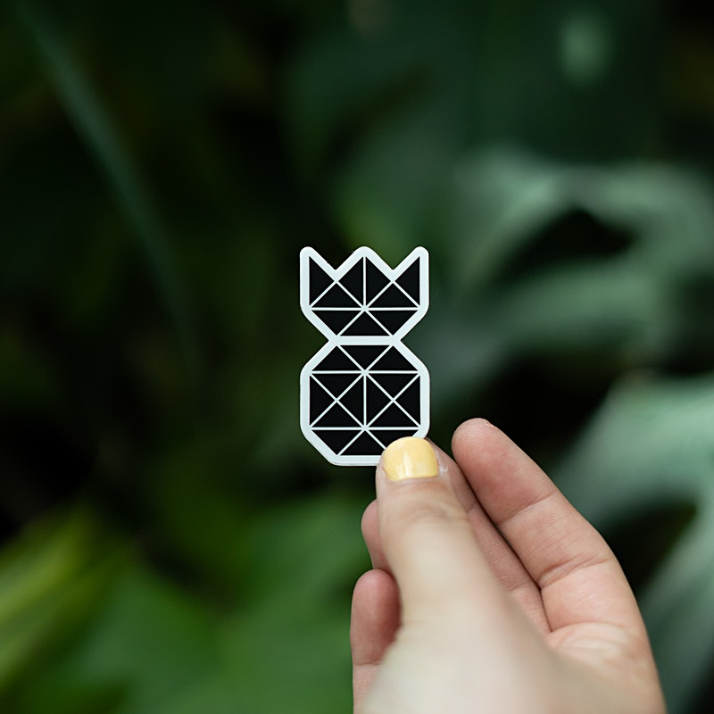 Black Pineapple Sticker held by girl to show scale