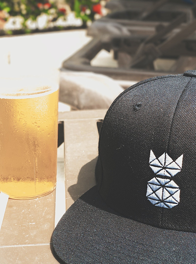 Real Classic Pineapple Snapback hat shot in Mexico and hat next to beer